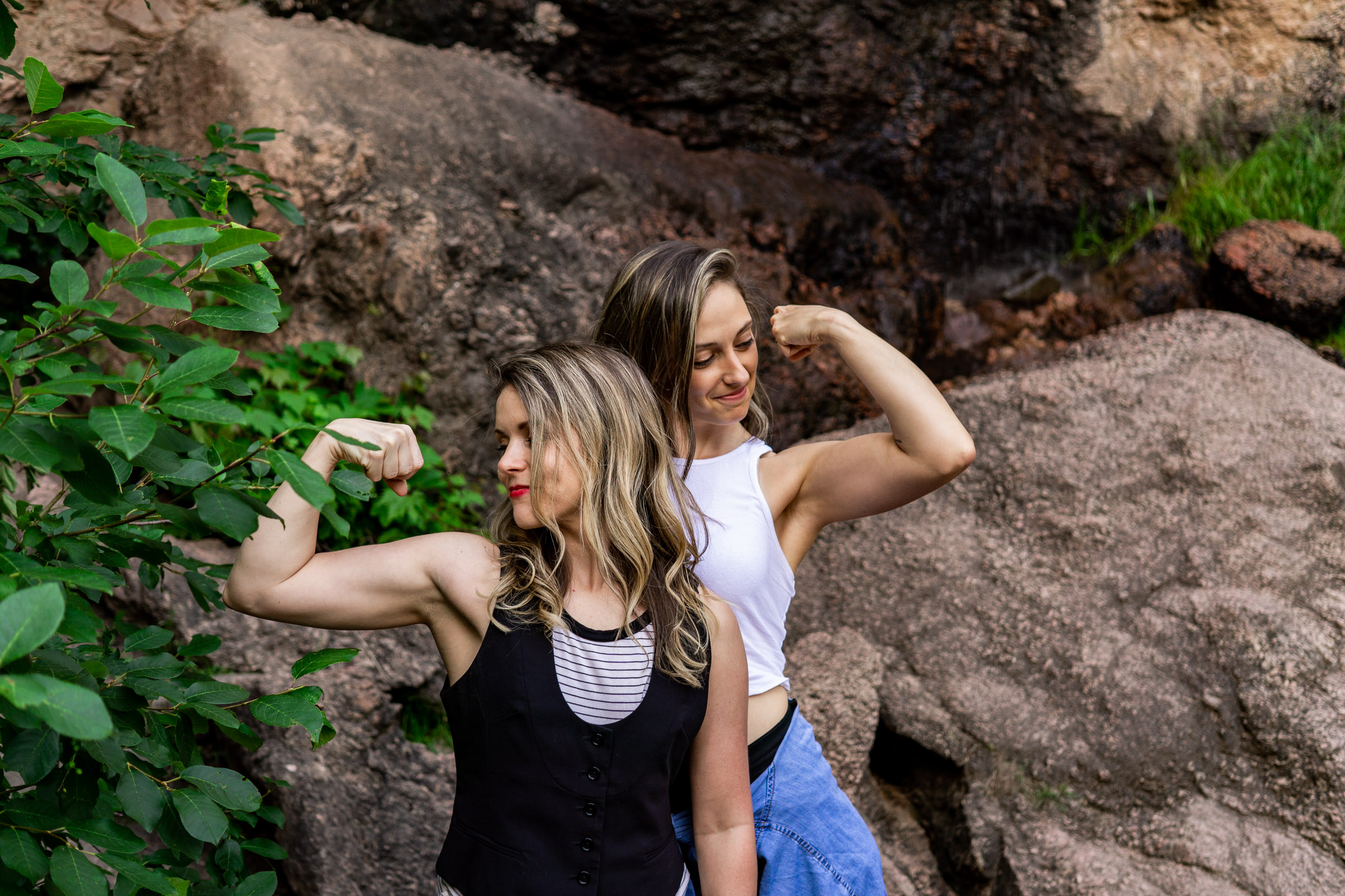 Two strong badass women compare biceps in this colorado engagement picture