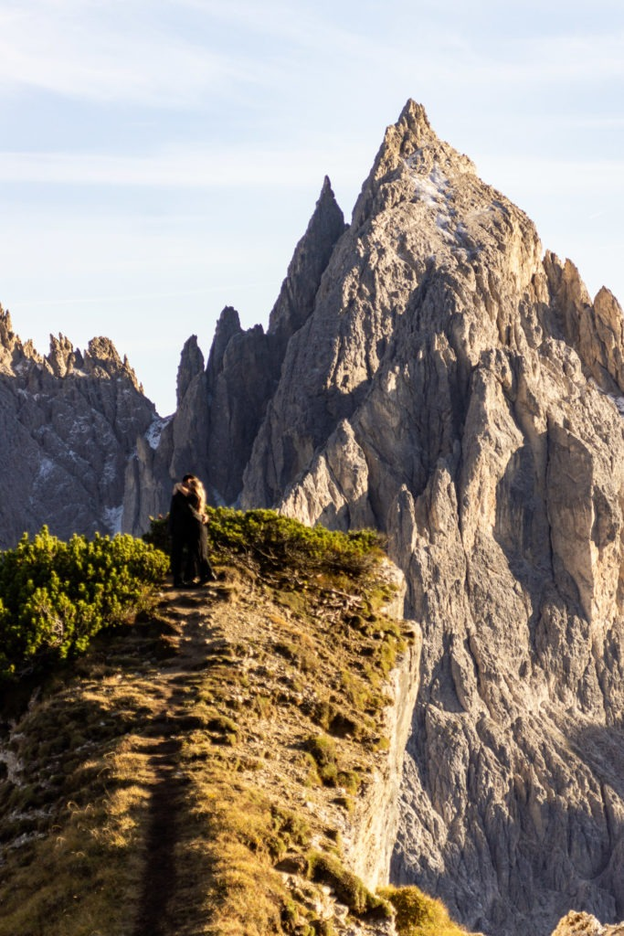 A tiny couple set against the craggy, harsh Dolomites mountains in Italy.