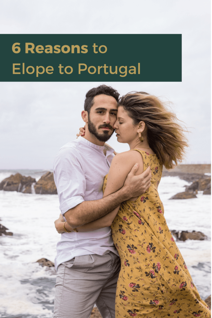 6 Reasons to consider a destination wedding in Portugal ~ Photo by Gabby Jockers Photography ~ Groom looking into the camera as he holds his bride gently in front of waves crashing on the rocks.