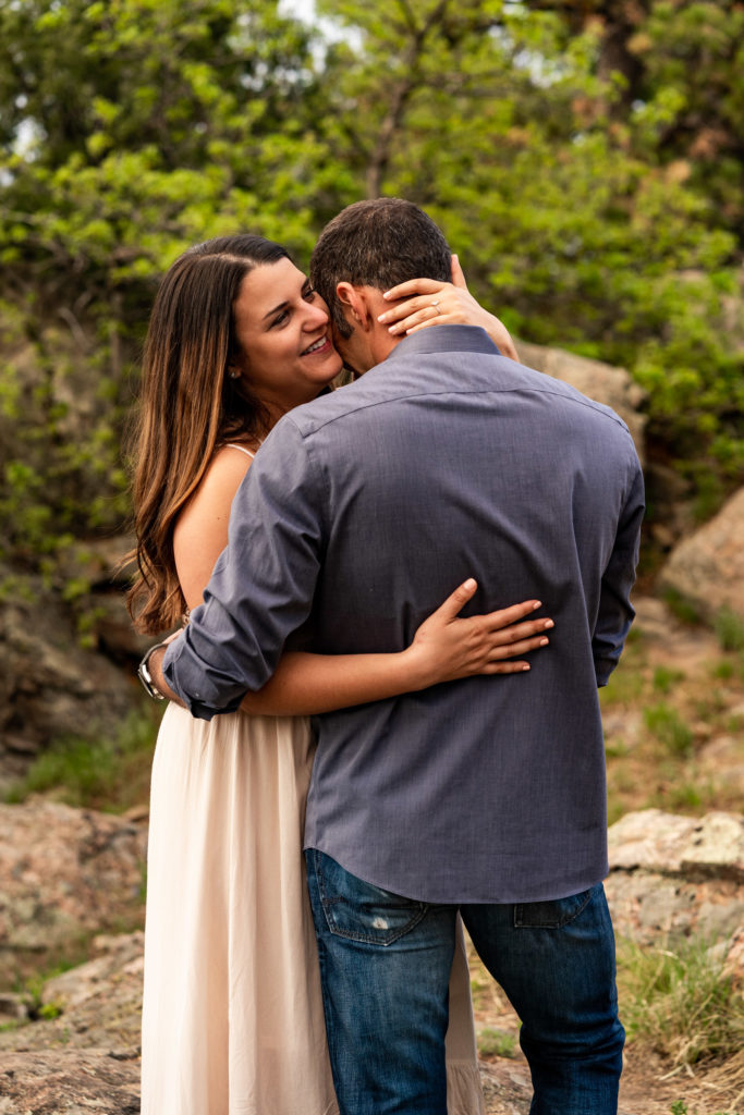 A couple laughing and having fun in front of castle ruins in Colorado. Photo by Gabby Jockers Photography. colorado engagement photography, colorado engagement photos, colorado engagement session, mt falcon engagement photos, mt falcon engagement session, denver engagement photography, denver engagement photos, castle engagement photos, sunset engagement session, hiking engagement, adventure photos, adventure session, couples photos, blue hour photos