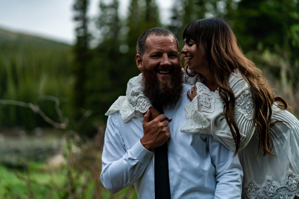 A couple holding onto each other and laughing. Photo by Gabby Jockers Photography. brainard lake engagement photography, brainard lake engagement photos, brainard lake engagement session, colorado engagement photos, colorado engagement session, colorado photography, mountain, engagement photos, sunset engagement session, hiking engagement, adventure photos, adventure session, couples photos, blue hour photos