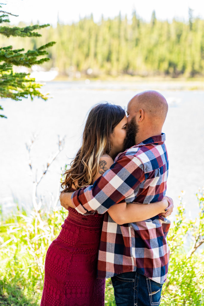 A couple hugging tightly with the woman's face pressed up against her fiance's bushy beard. Photo by Gabby Jockers Photography. colorado engagement photography, colorado engagement photos, colorado engagement session, brainard lake engagement photos, brainard lake engagement session, colorado photography, brainard lake engagement photos, mountain engagement photos, lake engagement photos, mountain engagement session, hiking engagement, adventure photos, adventure session, couples photos, morning engagement photos