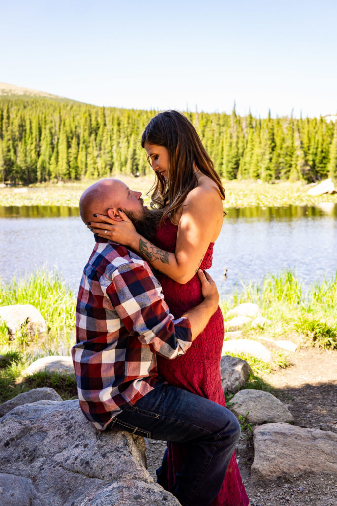A man and woman embracing and looking into each others eyes. Photo by Gabby Jockers Photography. colorado engagement photography, colorado engagement photos, colorado engagement session, brainard lake engagement photos, brainard lake engagement session, colorado photography, brainard lake engagement photos, mountain engagement photos, lake engagement photos, mountain engagement session, hiking engagement, adventure photos, adventure session, couples photos, morning engagement photos